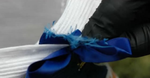 A ribbon had been cut from a book bag to use around Ira Yarmolenko's neck.